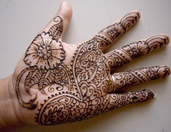 Floral and Paisley Mehndi Design on Palm for Women