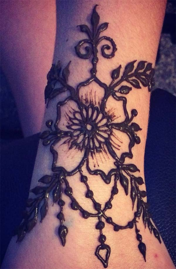 flower and leaves mehndi design for wrist
