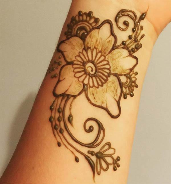 flowers and swirls mehndi design for wrist