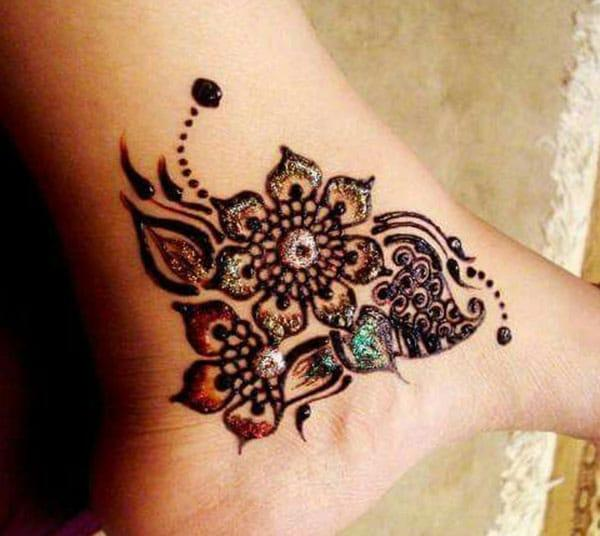 floral and leaf mehndi design for ankle