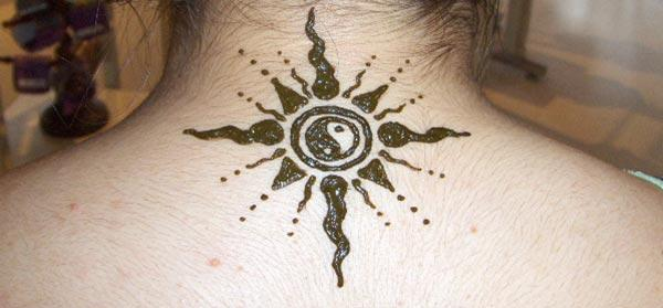sun with yin and yang mehndi design for neck