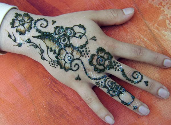 floral Mehandi design on back hand