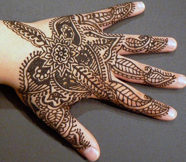 floral and paisley traditional Mehndi design on hand