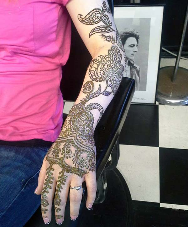 traditional floral and paisley mehndi design on full hand