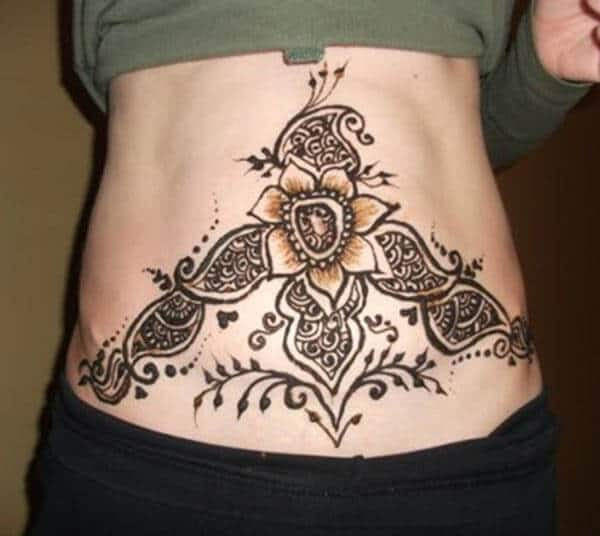 An eye-cathy stomach mehendi design for Girls
