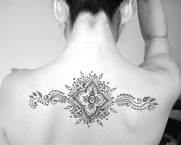 An elegant mehendi design on back for Ladies