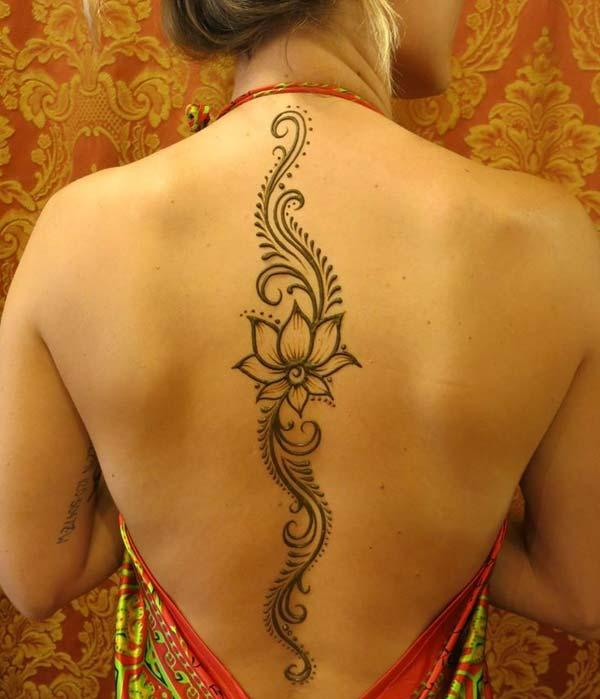 An enchanting back mehndi design for girls and women