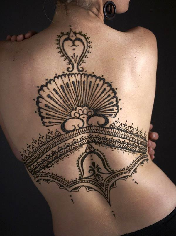 A majestic full back mehendi design for women and girls