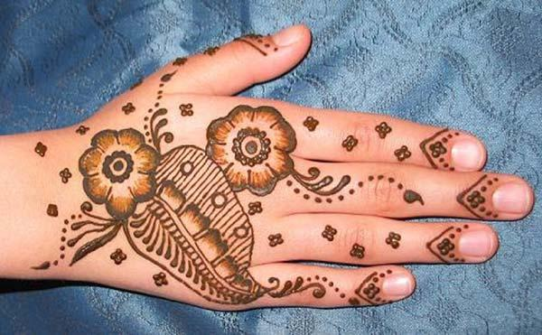 A lovely floral mehndi design on back hand for Ladies