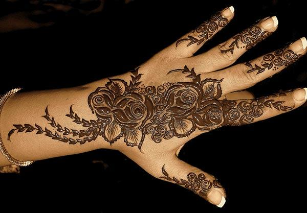 An intricate mehndi design on back hand for girls and women