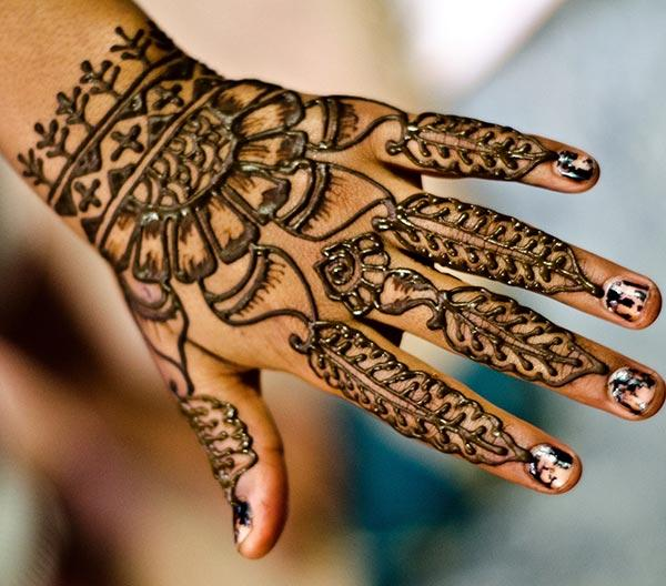 A delightful mehendi design on back hand for Girls