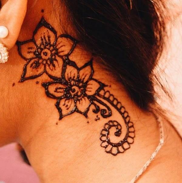An elegant floral neck mehendi design for Girls