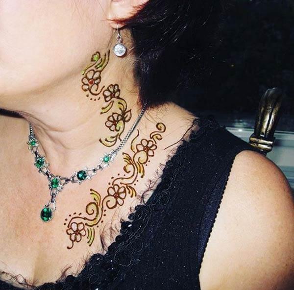 A marvelous neck mehendi design for women