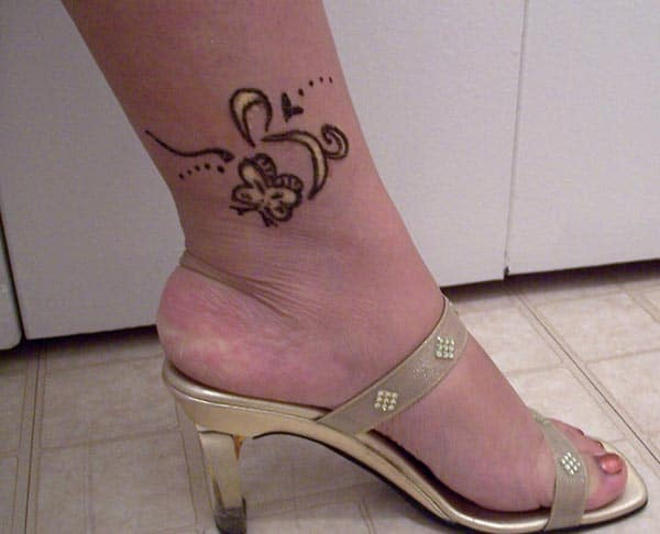 A cute little mehendi design on ankle for Women