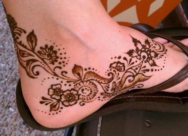 A mesmerizing floral ankle mehendi design for Girls and women