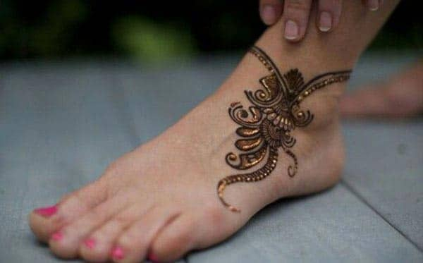 An embellished captivating ankle mehendi design for girls