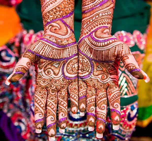 A vibrant stylish mehendi design on hand for brides
