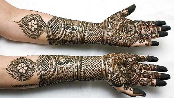 A heavenly full hand mehendi design for brides
