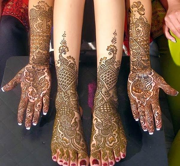 An aesthetic full hand and leg mehendi design for brides