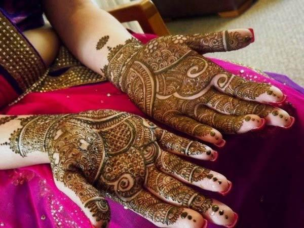 An elegant mehendi design on hand for brides