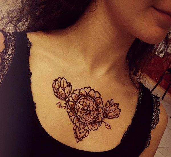 A bloomed flower chest mehendi design for Girls