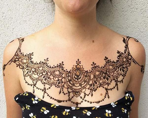 A magnificent chest mehendi design for Women