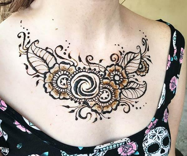 A captivating floral chest mehendi design for Girls and women