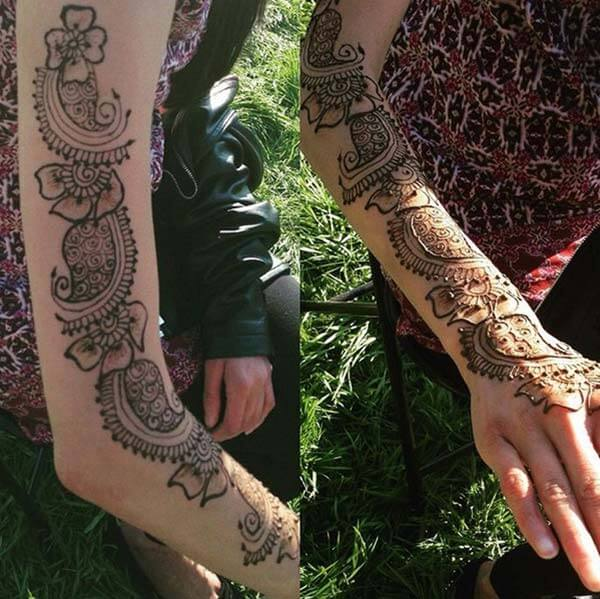 A lovely mehendi design on full arm for Girls