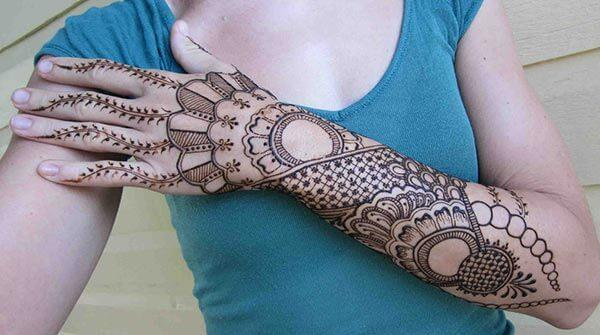 A captivating full arm mehendi design for Women