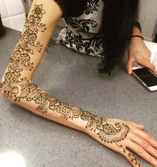 A royal mehndi design on full arm for girls and ladies