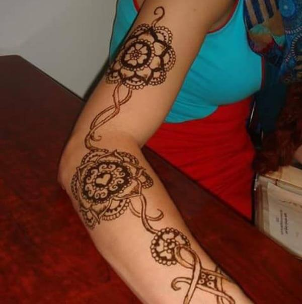 A lovely mehendi design on full arm for girls and women