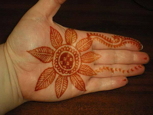 A cute palm mehendi design for women