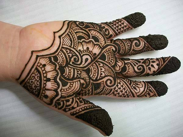 A stunning mehendi design on palm for Ladies and girls