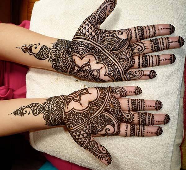A stylish symmetric palm mehendi design for Ladies