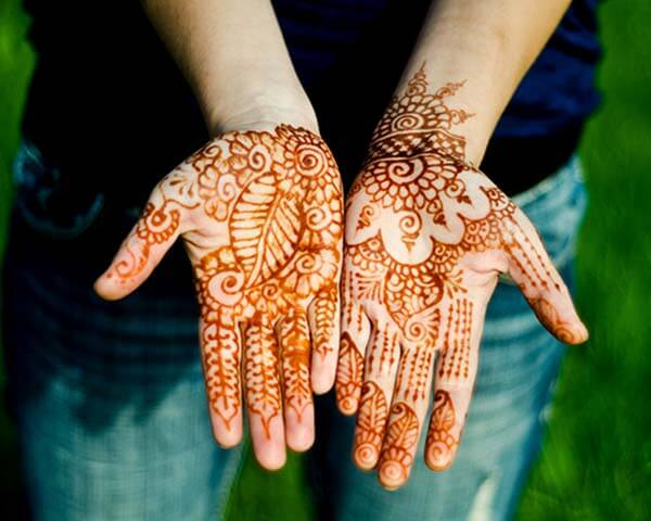 An engaging palm mehendi design for Women