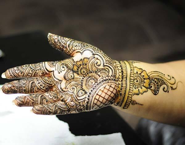 A striking palm mehendi design for ladies
