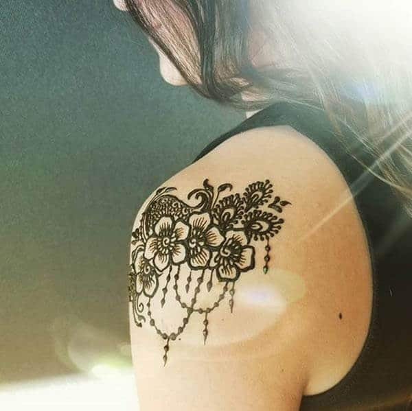A classic shoulder mehendi design for girls