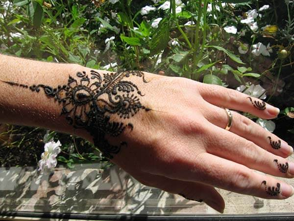 A charming wrist mehndi design for girls