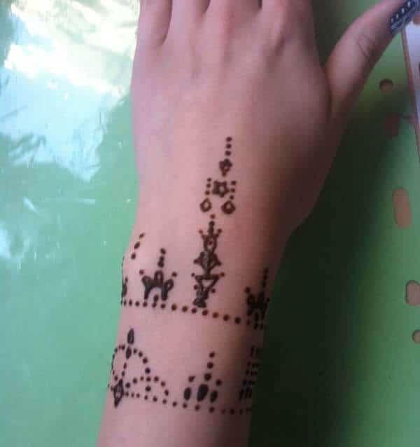 An artistic mehendi design on wrist for Women